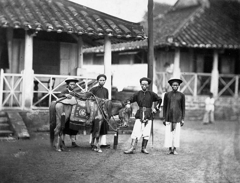 A rich man in Cochinchina with his horse and servants, 1886