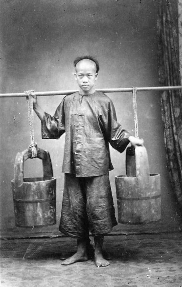 A young water-carrier in Saigon, 1880