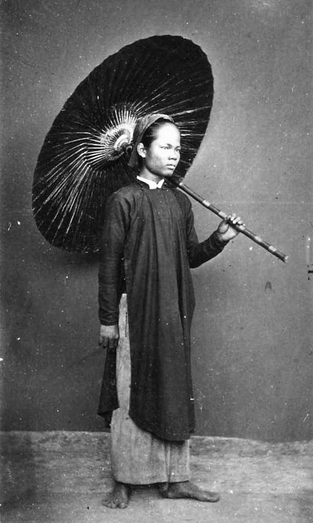 An Annamese man with his umbrella, 1880