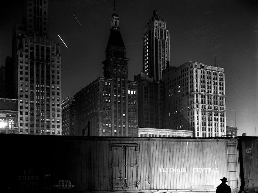 Illinois. Chicago Noir. Special agent making his rounds at night at the South Water Street freight terminal of the Illinois Central Railroad, Chicago, May 1943