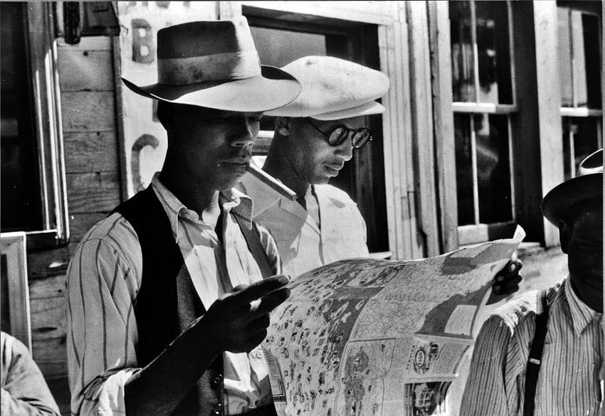 North Carolina. Map Quest. Florida migrants studying a road map before leaving Elizabeth City for the state of Delaware, 1940