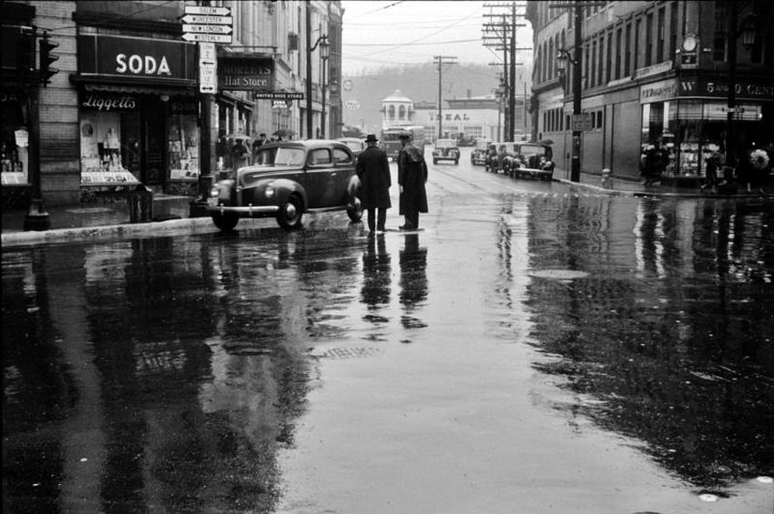 Connecticut. Mercury on Main. A rainy day view of a main street intersection in Norwich, November 1940