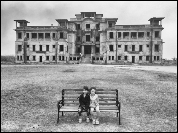 The photographer's daughters in front of the notorious Bokor Hill Casino. Abandoned at that time but renovated recently / kampot, march 2016