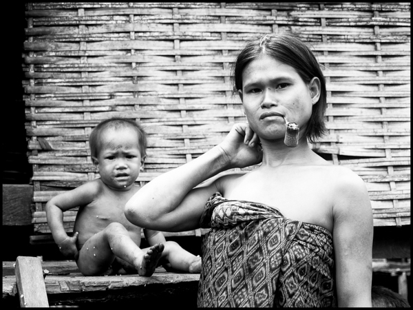 A young hill tribe mother smoking a pipe in Banlung, Ratanakiri Province ratanakiri province, june 2006
