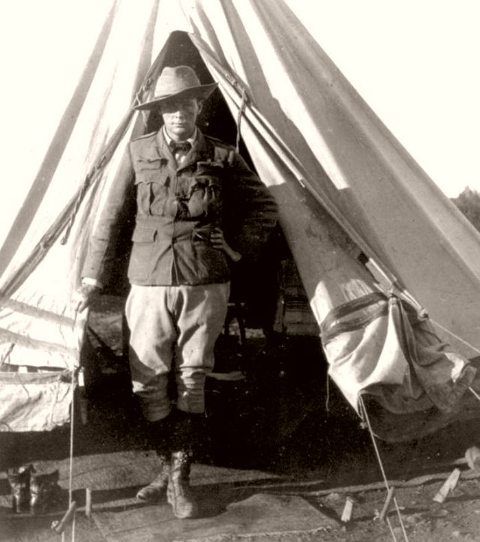Churchill standing at the opening of his tent as a war correspondent during the Second Boer War, in Bloemfontein, South Africa, 1900.