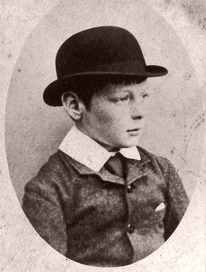 Churchill pictured as a child and wearing a bowler hat.