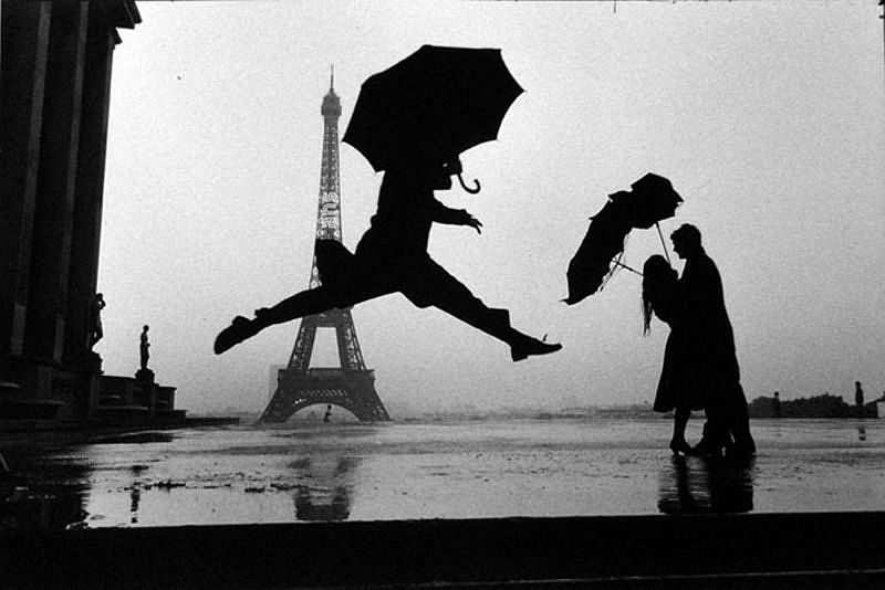 Elliott Erwitt, Paris, France (Man Jumping with Umbrella)