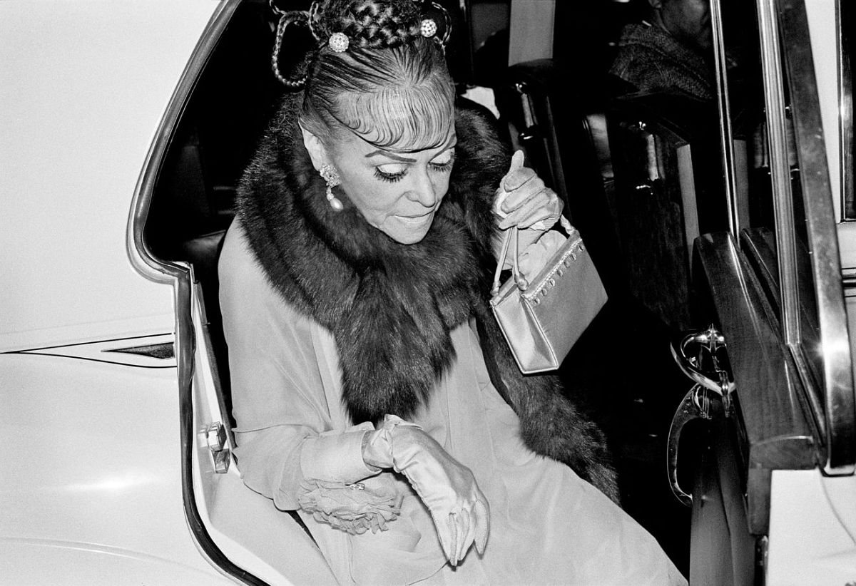 Michael Jang, Woman Arriving in a Rolls Royce, 1973, vintage gelatin silver print. Courtesy of the artist / © Michael Jang