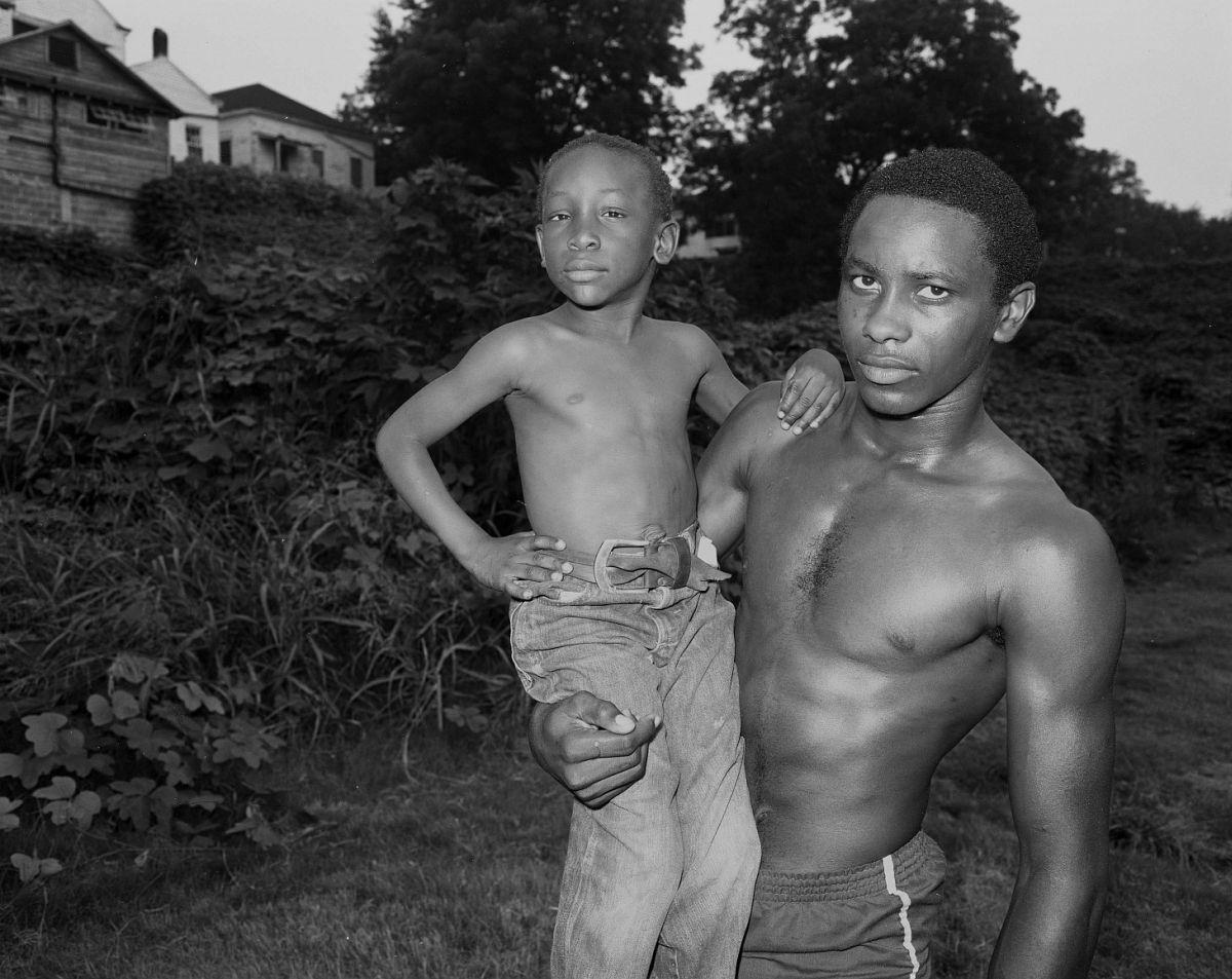 Vicksburg, Mississippi - Young Man and Boy at Dusk  1983