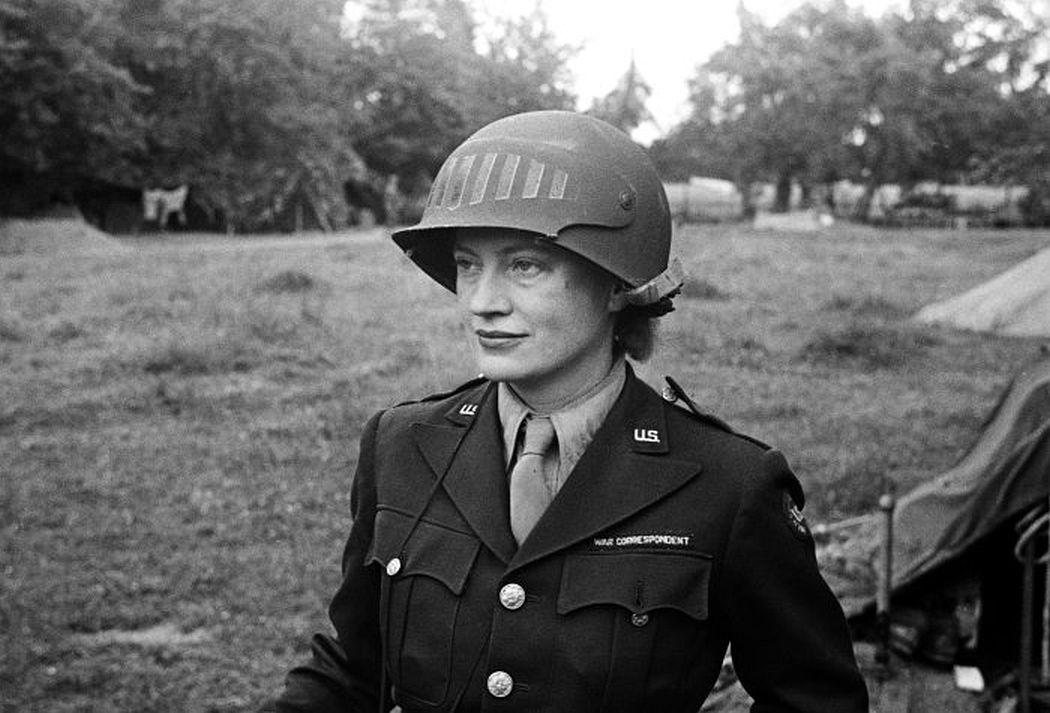 Lee Miller wearing a special helmet borrowed from U.S Army photographer Don Sykes (Sergeant), Normandy France, 1944 © Lee Miller Archives, England 2020 All rights reserved. leemiller.co.uk